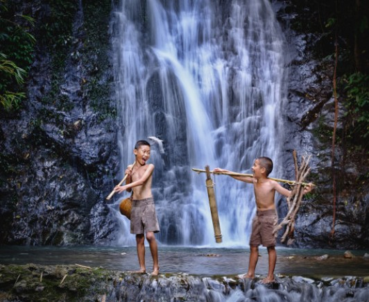two-boy-play-laugh-fishing-waterfall-countryside-thailand_28914-462
